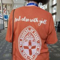 A volunteer at General Convention obligingly models their signature T-shirt. NINA NICHOLSON PHOTO