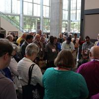 "Bishops Mark Beckwith and Mariann Budde of Washington lead a 5-minute ""pop up"" liturgy in the Austin Convention Center on behalf of Bishops United Against Gun Violence. NINA NICHOLSON PHOTO"