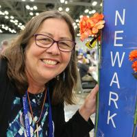 July 11: Martha Gardner, who's here working at the CPG booth in the exhibit hall, drops by the visit the Newark deputation. NINA NICHOLSON PHOTO