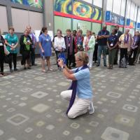 Diana Wilcox photographs participants in Purple Scarf Day at General Convention. SHARON HAUSMAN PHOTO