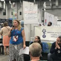 July 10: Laura Russell gives a talk at the Episcopal Peace Fellowship booth in the exhibit hall. DIANA WILCOX PHOTO