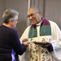 The Rev. Canon Gregory Jacobs gives Communion at the opening Eucharist of Convention. NINA NICHOLSON PHOTO