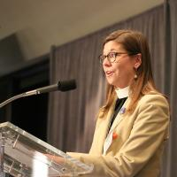 The Rev. Allison Liles, Executive Director of Episcopal Peace Fellowship, speaking at Convention. NINA NICHOLSON PHOTO