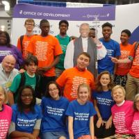 July 10: The youth contingent, wearing PB quote T-shirts, has a photo op with the PB cutout in the exhibit hall. PHOTO COURTESY KATHRYN KING