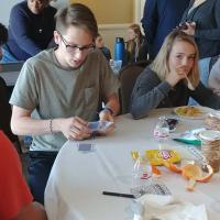 The teens play games and eat hot meals provided for them by members of the Diocese of Newark. KATHRYN KING PHOTO