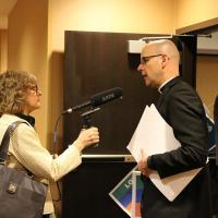 The Rev. John Mennell speaks to a reporter. NINA NICHOLSON PHOTO