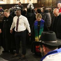 The interfaith clergy pray together in Grace Church, Newark after Guerrero receives his extension. NINA NICHOLSON PHOTO
