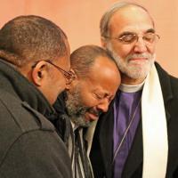 Bishop Beckwith and the Rev. Joseph Harmon comfort Richard McDowell. NINA NICHOLSON PHOTO
