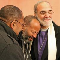 Bishop Beckwith and the Rev. Joseph Harmon comfort Richard McDowell. NINA NICHOLSON PHOTO