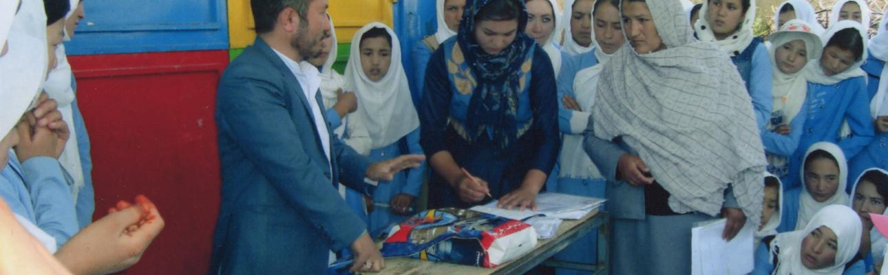 Students and teachers at the Yakawlang Central Girls High School in Afghanistan gather for the twice-yearly delivery of letters from American pen-pals. PHOTO COURTESY AFGHAN SCHOOL PROJECT