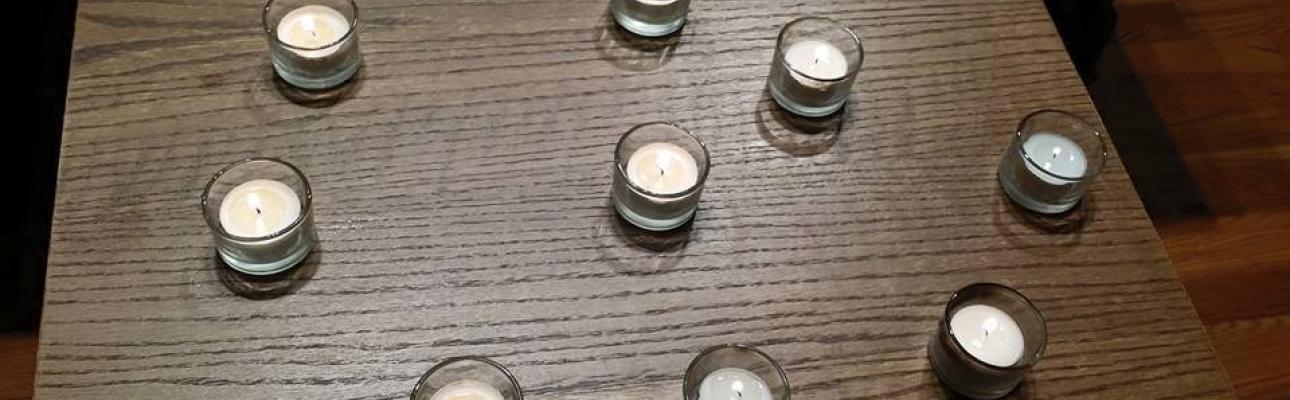 Nine votive candles representing Charleston shooting victims