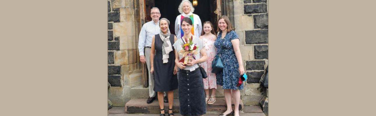 Christina (front) with her family and rector following the renaming liturgy.