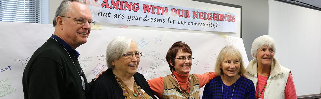 "Author Barbara Djimopoulos and other members of the Harrington Park ""Going Local"" guiding team stand in front of their Dream Board at the October 1 meeting. L-r: Paul Shackford, Barbara Djimopoulos, Coach Deborah Drake, Kathy Ferdinand and Cathie Ruppi. NINA NICHOLSON PHOTO"