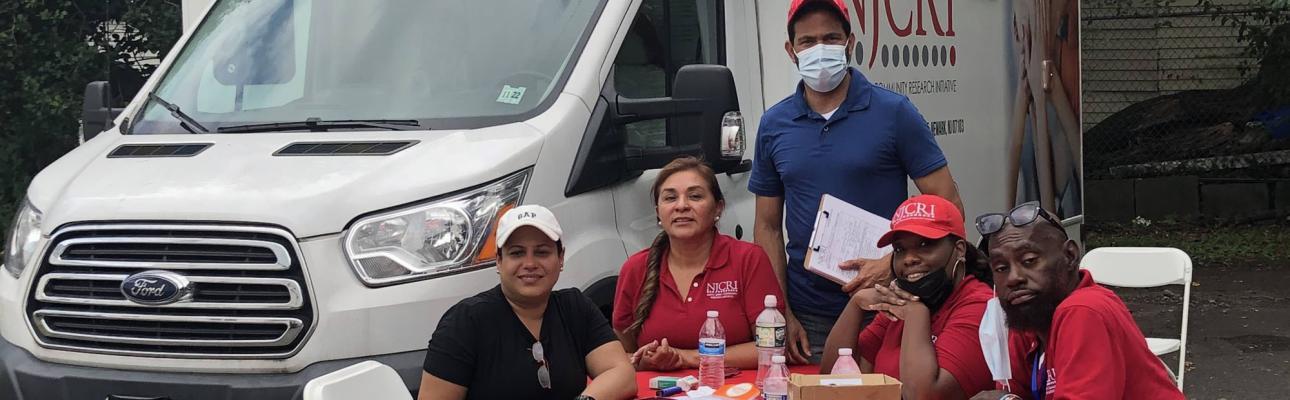 The NJCRI team and their mobile COVID vaccine clinic. ALEEDA CRAWLEY PHOTO