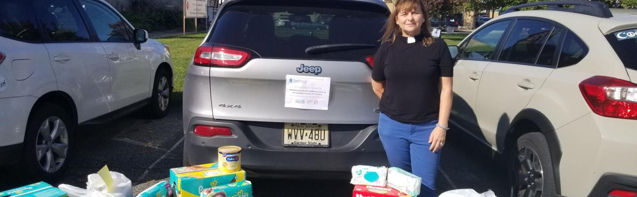 The Rev. Ellen Kohn-Perry, president of North Porch, with donations at their Dover location.