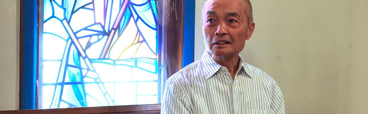 Gary Eng pauses for a moment of reflection in the nave of St. Paul's, North Arlington. NINA NICHOLSON PHOTO