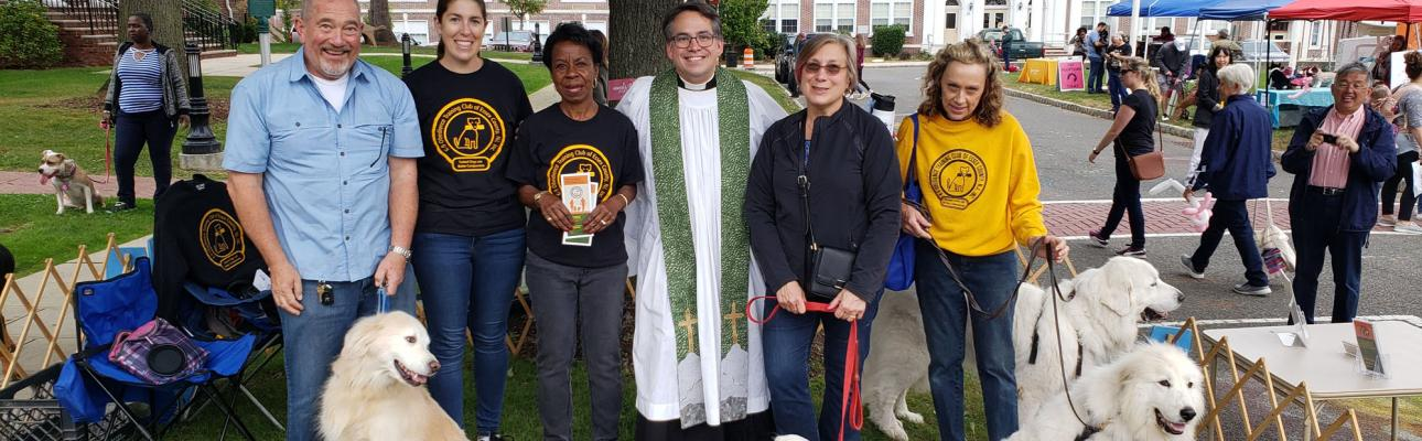 """The Rev. Jerry Racioppi of Holy Spirit, Verona with members of the K-9 Obedience Training Club of Essex County, who led dogs in exhibitions of obedience and agility at Holy Spirit's """"A Celebration of Pets"""" in the Verona Town Hall Square. RANDY JOHNSON PHOTO"""