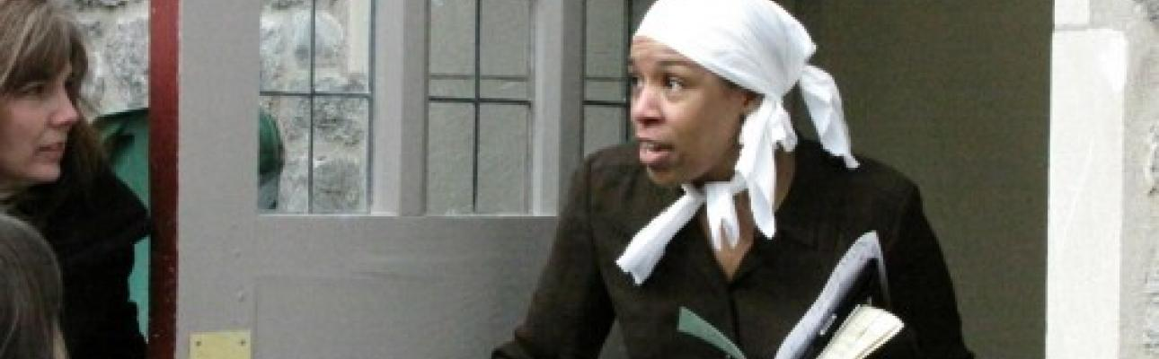 Danielle Baker playing the role of Underground Railroad conductor Harriet Tubman